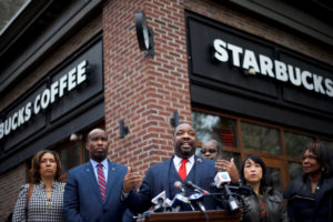 Philadelphia Councilman Kenyatta Johnson (C) addresses the media along with colleagues, outside the Center City Starbucks, where two black men were arrested, in Philadelphia, Pennsylvania U.S. April 16, 2018.REUTERS/Mark Makela.