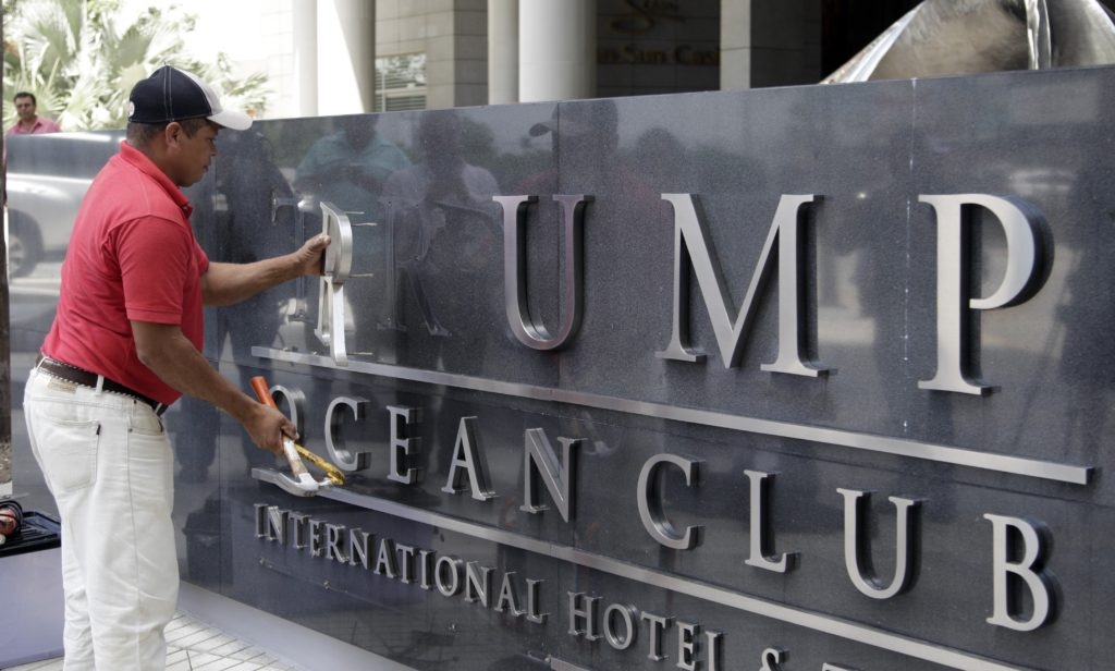 A worker removes the Trump sign letters from outside the hotel in Panama City on March 5, 2018. The new owner of the luxury hotel Trump in Panama said that he managed to expel from the administration of the business the company linked to the president of the United States, Donald Trump, with which he has a complex lawsuit in the United States, which Panamanian prosecutors are investigating. STR/AFP/Getty Images