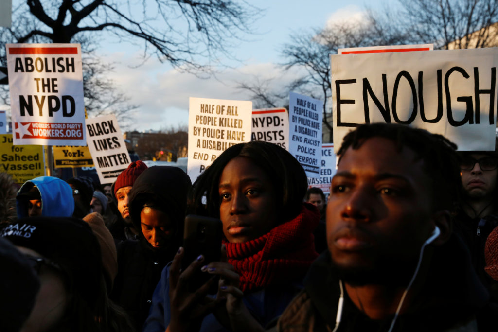 Demonstrators gather to protest the killing of Saheed Vassell by New York Police Department officers in the Brooklyn borough of New York, U.S., April 5, 2018. REUTERS/Lucas Jackson
