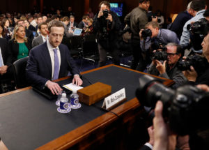 Facebook CEO Mark Zuckerberg arrives to testify before a Senate Judiciary and Commerce Committees joint hearing regarding the company's use and protection of user data on Capitol Hill in Washington, U.S., April 10, 2018. REUTERS/Aaron P. Bernstein - HP1EE4A1GGH5C