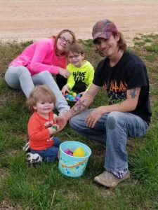 Casey Britton poses with her husband, Norbie Britton, and her sons, Seth, 5, and Gavin, 2, after an Easter egg hunt in April. Photo courtesy of Casey Britton.