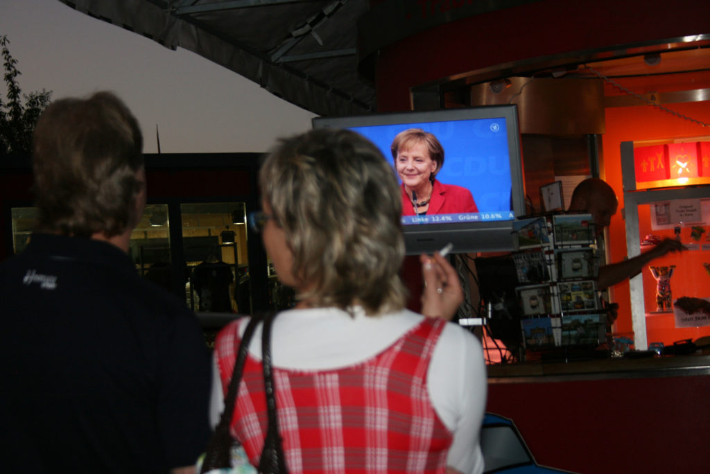 Germans watch Chancellor Angela Merkel on an outdoor television in September 2009. Photo by Larisa Epatko/PBS NewsHour