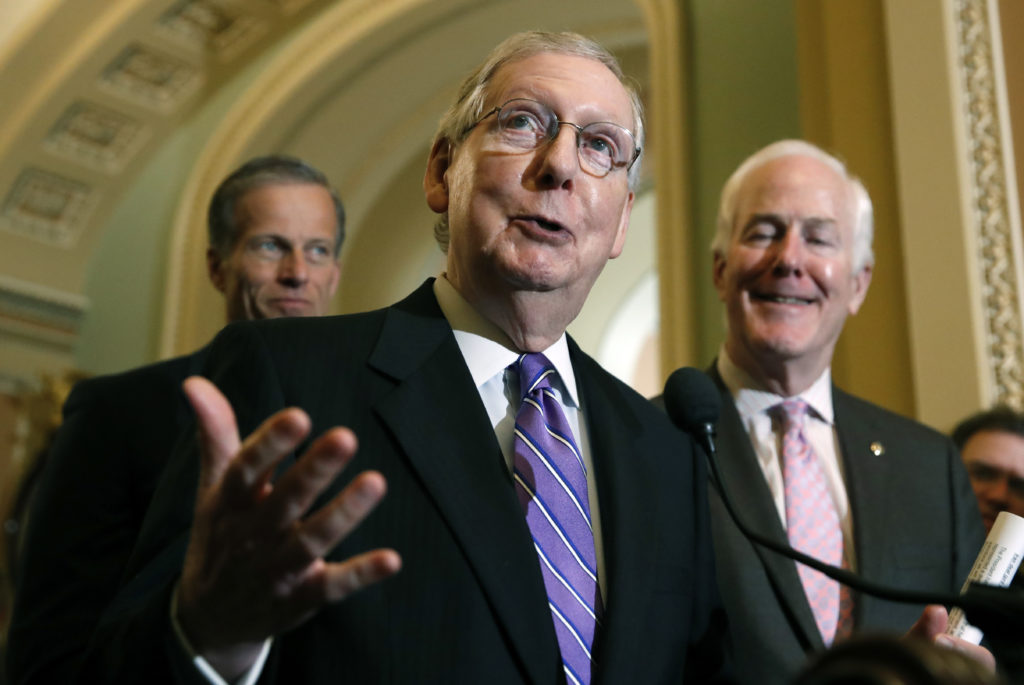 Senate Majority Leader Mitch McConnell of Ky., center, speaks during a media availability after a policy luncheon on Capitol Hill, Tuesday, May 8, 2018 in Washington. McConnell is accompanied by Sen. John Thune, R-S.D., left, and Sen. John Cornyn, R-Texas. (AP Photo/Alex Brandon)