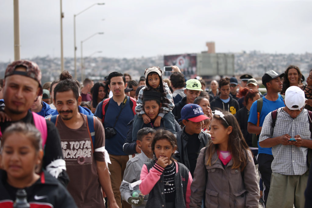 Members of a caravan of migrants from Central America walk towards the United States border and customs facility, where they are expected to apply for asylum, in Tijuana, Mexico April 29, 2018. Photo by REUTERS/Edgard Garrido