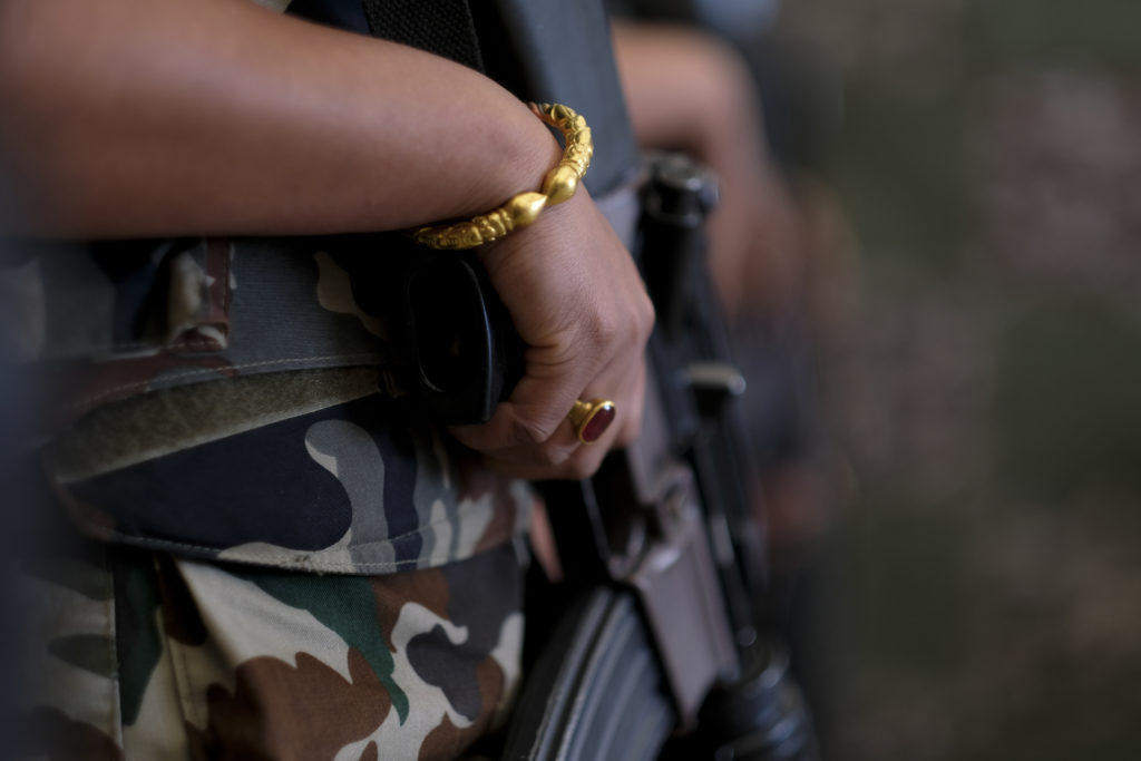 The hand of a female Nepalese Army U.N. peacekeeper rests on her weapon. Photo by Sebastian Rich