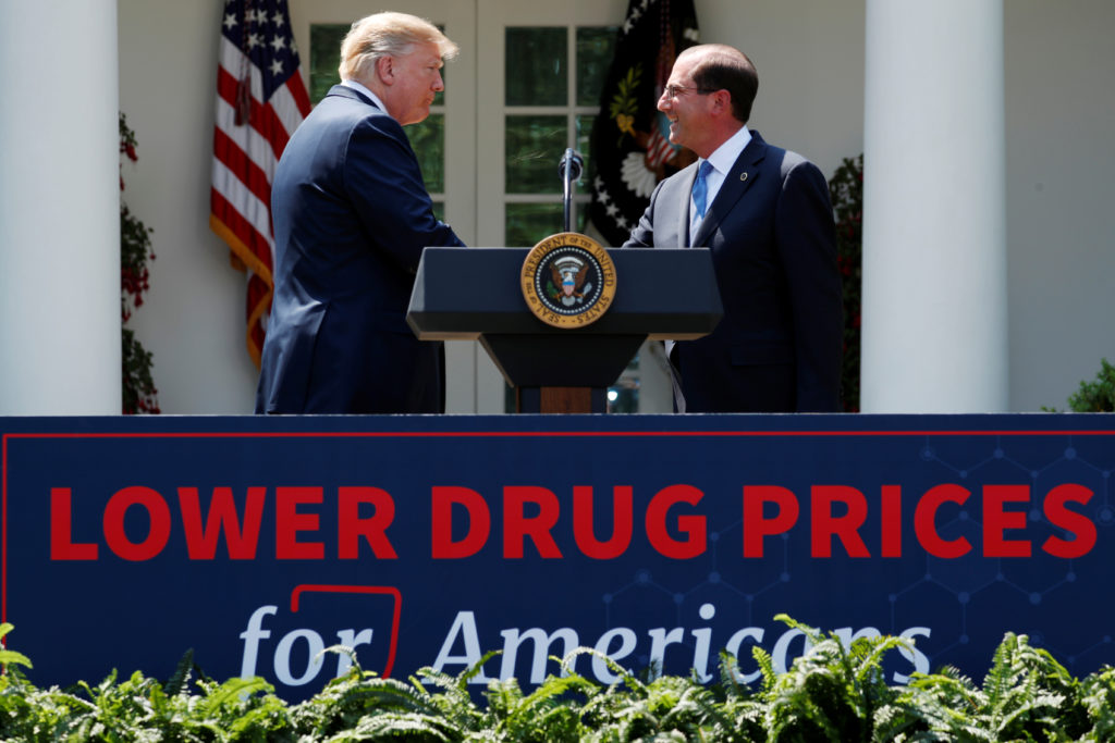 Health and Human Services Secretary Alex Azar is greeted by U.S. President Donald Trump after Trump delivered a speech about lowering prescription drug prices from the Rose Garden at the White House in Washington, U.S., May 11, 2018. REUTERS/Jonathan Ernst