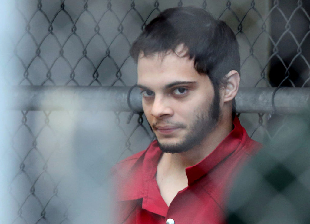 FILE PHOTO - Esteban Santiago is taken from the Broward County main jail as he is transported to the federal courthouse in Fort Lauderdale, Florida, U.S. on January 9, 2017. Courtesy Amy Beth Bennett/South Florida Sun Sentinel via REUTERS/File Photo