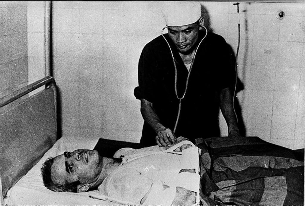 HANOI, VIET NAM:  A photo taken in 1967 shows US Navy Airforce Major John McCain being examined by a Vietnamese doctor. John McCain, current US presidential hopeful, was captured in 1967 at a lake in Hanoi after his Navy warplane was been downed by Northern Vietnamese army during the Vietnam War. One of his rescuers said 24 February 2000, McCain was well treated after being pulled from the lake by villagers. McCain said that upon capture he was beaten by an angry mob and bayoneted in the groin.  (B/W ONLY) AFP PHOTO (Photo credit should read AFP/Getty Images)