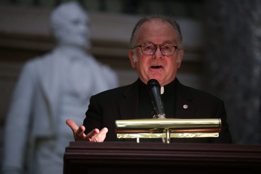 House Chaplain, Father Pat Conroy, speaks during a memorial service at the National Statuary Hall of the Capitol in September, in Washington, D.C. Photo by Alex Wong/Getty Images