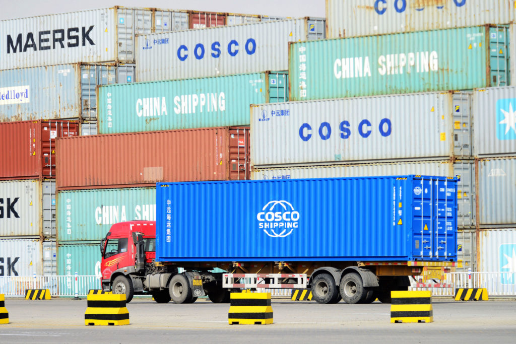 A truck moves a shipping container at Qingdao Port in Qingdao, China. Trade tensions between the U.S., China and other countries have escalated in recent months. Photo by VCG/VCG via Getty Images