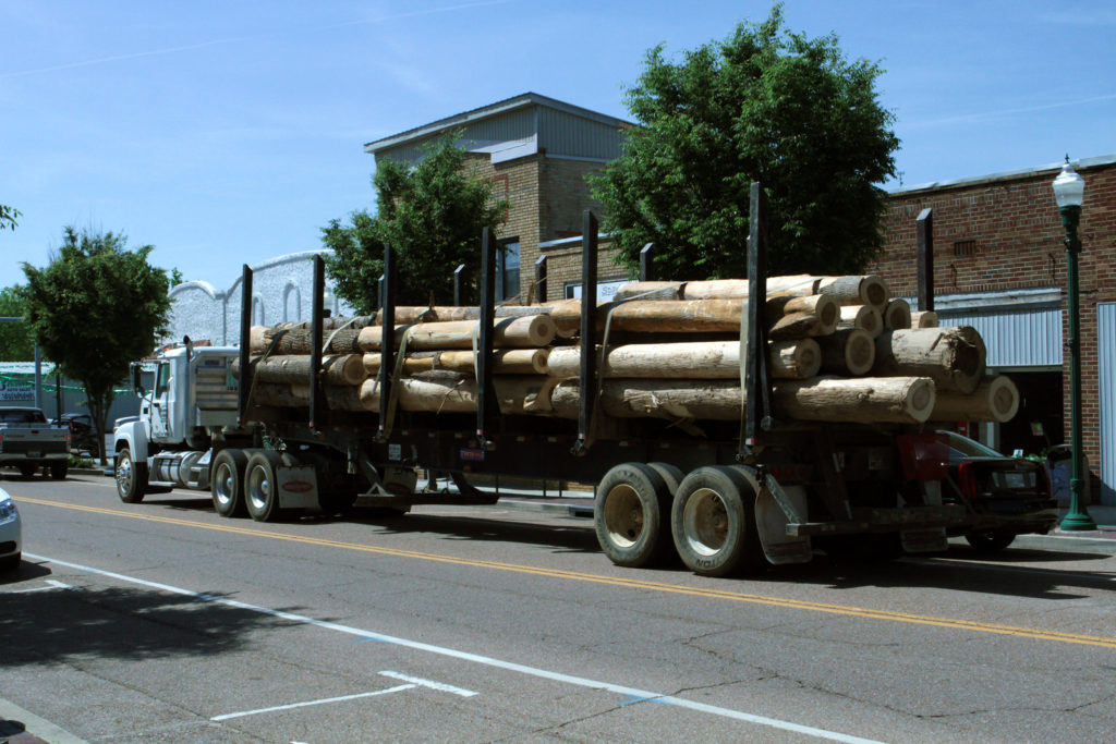 A lumber truck drives through downtown Linden, Tennessee. Two sawmills are among Linden's most prominent employers. Photo by Laura Santhanam/PBS NewsHour.