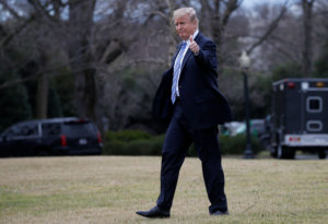 U.S. President Donald Trump walks to Marine One to depart for travel to Florida from the South Lawn of the White House in Washington, U.S., February 16, 2018. REUTERS/Leah Millis