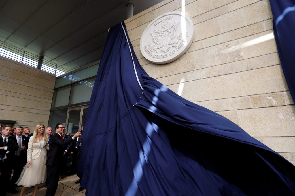 U.S. Treasury Secretary Steven Mnuchin unveils the seal for the new U.S. embassy, as he stands next to Senior White House Adviser Ivanka Trump during the dedication ceremony of the new U.S. embassy in Jerusalem. Photo by Ronen Zvulun/Reuters