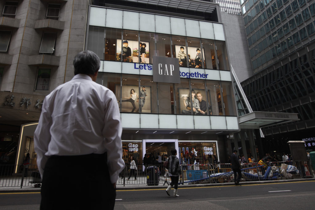 A man stands in front of a Hong Kong's first Gap Store before its opening in the financial Central district. Photo by Tyrone Siu/Reuters