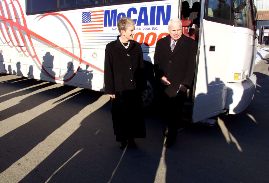 Shadows from waiting media fall upon Republican presidential hopeful John McCain and his wife Cindy as they arrive for the Raymond town meeting January 29. McCain is making his way around the state in frantic bid to win the Febraury 1 primary.  KL/JP - RP2DRHYURPAB