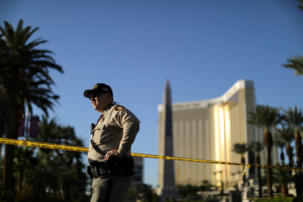 A police officer stands in front of the closed Las Vegas Strip next to the site of the Route 91 music festival mass shooting outside the Mandalay Bay Resort and Casino in Las Vegas, Nevada, U.S., October 3, 2017. REUTERS/Lucy Nicholson - RC136F2FEA50
