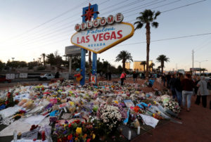 "The ""Welcome to Las Vegas"" sign is surrounded by flowers and items, left after the October 1 mass shooting, in Las Vegas, Nevada U.S. October 9, 2017. REUTERS/Las Vegas Sun/Steve Marcus - RC1C5767FCA0"
