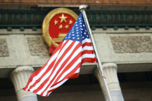 A U.S. flag is seen during a welcoming ceremony in Beijing, China. Photo by Thomas Peter/Reuters