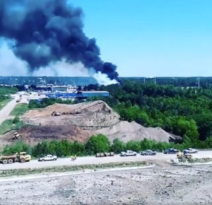 Smoke rises from the site where a Puerto Rico Air National Guard cargo plane crashed near Savannah, Georgia, in this still image taken from a May 2, 2018, video obtained from social media. Photo by Roger Best via Reuters