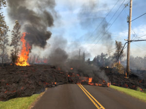 Lava advances along a street near a fissure in Leilani Estates, on Kilauea volcano's lower East Rift Zone, Hawaii. Photo by U.S. Geological Survey/Handout via Reuters