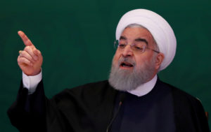Iranian President Hassan Rouhani speaks during a 2018 meeting with Muslim leaders and scholars in Hyderabad, India. Photo by Danish/Reuters