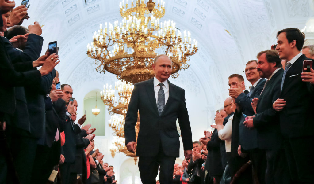 Russian President Vladimir Putin walks before an inauguration ceremony at the Kremlin in Moscow. Photo by Alexander Zemlia...