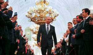 Russian President Vladimir Putin walks before an inauguration ceremony at the Kremlin in Moscow. Photo by Alexander Zemlianichenko/Pool via Reuters
