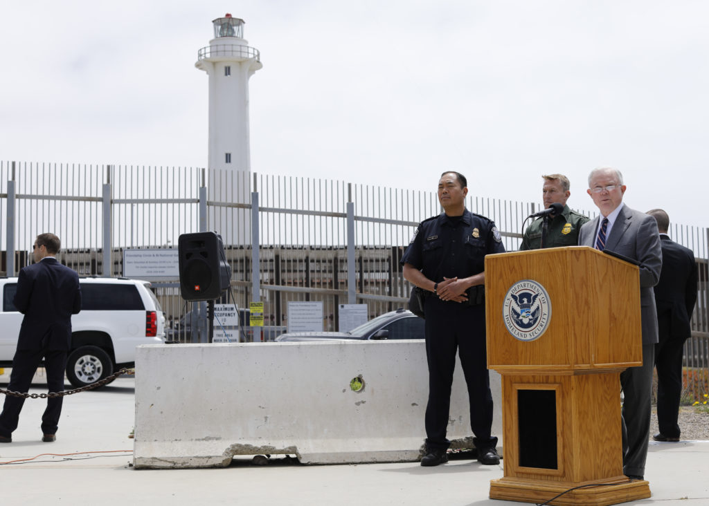Attorney General Jeff Sessions speaks during a visit to the U.S. Mexico border wall for a press conference with Immigration and Customs Enforcement Deputy Director Thomas D. Homan, discussing immigration enforcement actions of the Trump Administration near San Diego, California. Photo by Mike Blake/Reuters