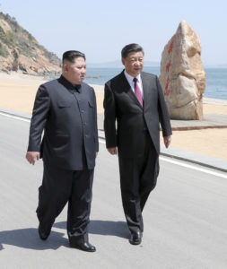 Chinese President Xi Jinping and North Korean leader Kim Jong Un meet in Dalian, Liaoning province, China in this picture released by Xinhua on May 8, 2018. Photo by Xie Huanchi/Xinhua via Reuters