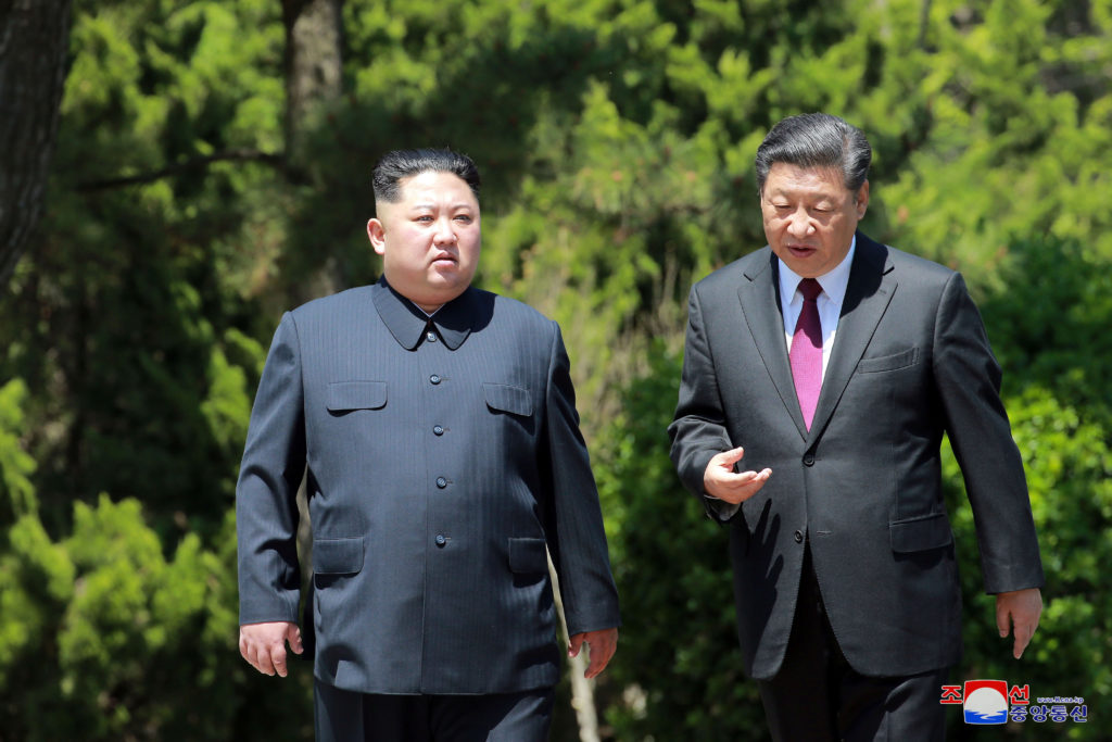 North Korean leader Kim Jong Un visits with China's President Xi Jinping in Dalian, China in this undated photo released on May 9 by North Korea's Korean Central News Agency. Photo by KCNA/via Reuters