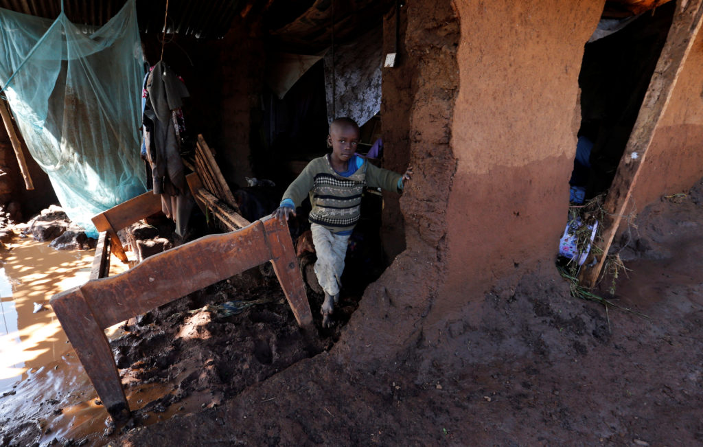 A child walks in his house, which was partly destroyed by flooding water after the dam burst. Photo by Thomas Mukoya/Reuters