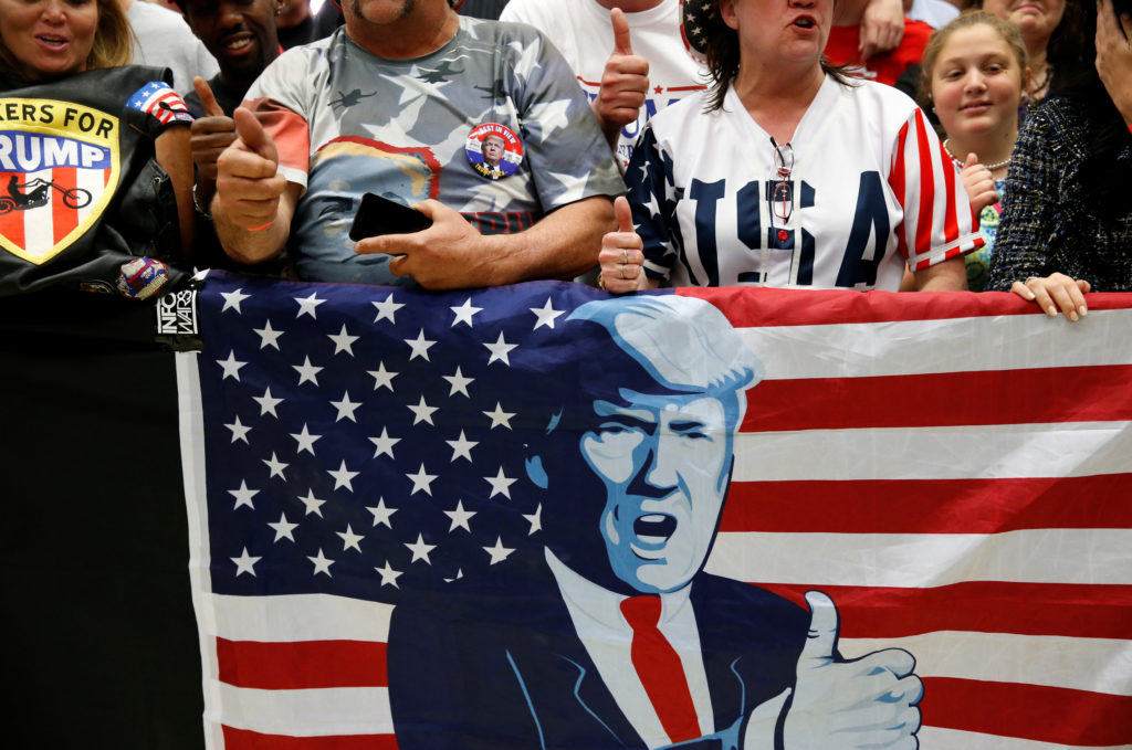 Supporters of U.S. President Donald Trump cheer as they wait for him to appear at a rally with supporters at North Side middle school in Elkhart, Indiana, U.S., May 10, 2018. REUTERS/Leah Millis - RC177AA93D30