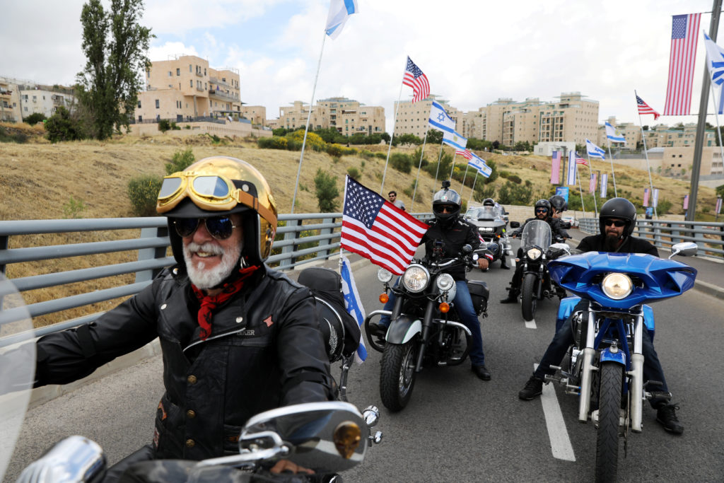 Motorcyclists from the Israeli Samson Riders motorcycle club are seen in the streets of Jerusalem with U.S. flags, on their way from the U.S. embassy in Tel Aviv to the location of the new U.S. embassy in Jerusalem