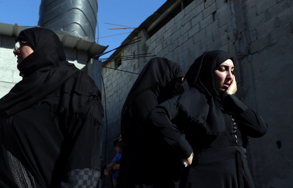 A relative of a Palestinian, who was killed during a protest at the Israel-Gaza border, mourns during his funeral in Khan Younis in the southern Gaza Strip. Photo by Ibraheem Abu Mustafa/Reuters