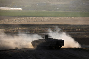 An Israeli armoured personnel carrier (APC) maneuvers on the Israeli side of the border fence between Israel and the Gaza Strip May 14, 2018. REUTERS/Amir Cohen - RC1E91AAAA10