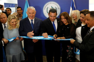 Hilda Patricia Marroquin, the wife of Guatemalan President Jimmy Morales (center), cuts the ribbon during the dedication ceremony of the embassy of Guatemala in Jerusalem with Israeli Prime Minister Benjamin Netanyahu and his wife Sara at their side on May 16. Photo by Ronen Zvulun/Pool via Reuters
