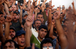 Palestinian demonstrators chant slogans during a protest demanding the right to return to their homeland, at the Israel-Gaza border, east of Gaza City. Photo by Mohammed Salem/Reuters