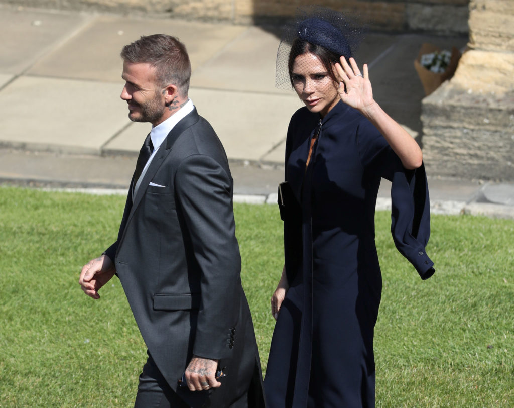 Soccer star David Beckham and clothing designer Victoria Beckham arrive at the castle. Photo by Andrew Milligan/Pool via Reuters