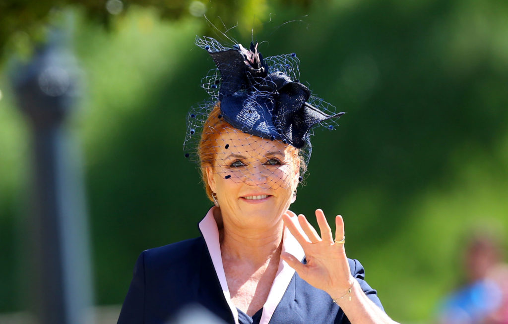 Sarah Ferguson, the duchess of York, waves to the spectators. Photo by Gareth Fuller/Pool via Reuters