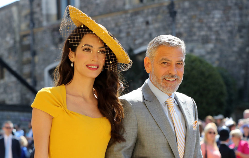 Amal Clooney and George Clooney are among the friends attending the wedding. Photo by Gareth Fuller/Pool via Reuters