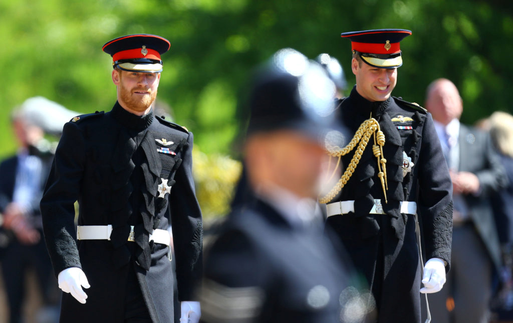 Prince Harry walks with his best man and brother Prince William to the ceremony. Photo by Gareth Fuller/Pool via Reuters
