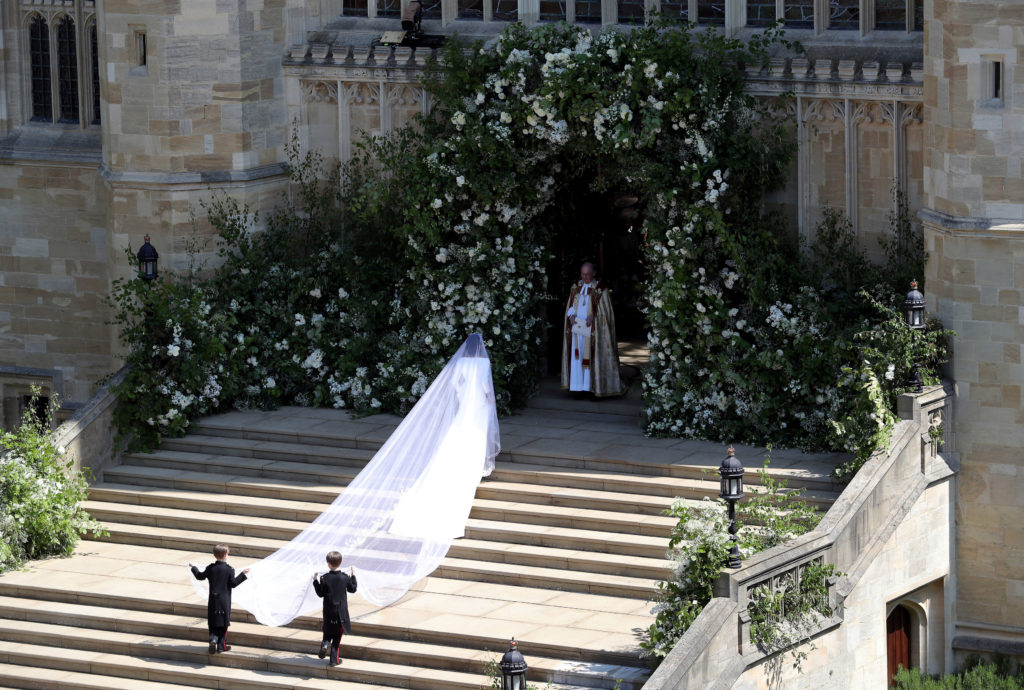 Meghan Markle's gown was designed by Britain's Clare Waight Keller of French fashion house Givenchy. Photo by Andrew Matthews/Pool via Reuters