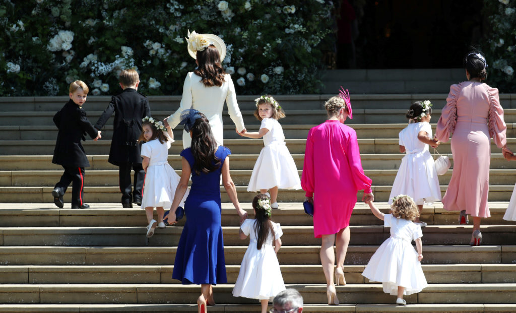 The Duchess of Cambridge Kate Middleton (wearing ivory dress) arrives with the flower girls and page boys at St. George's Chapel. Photo by Jane Barlow/Pool via Reuters