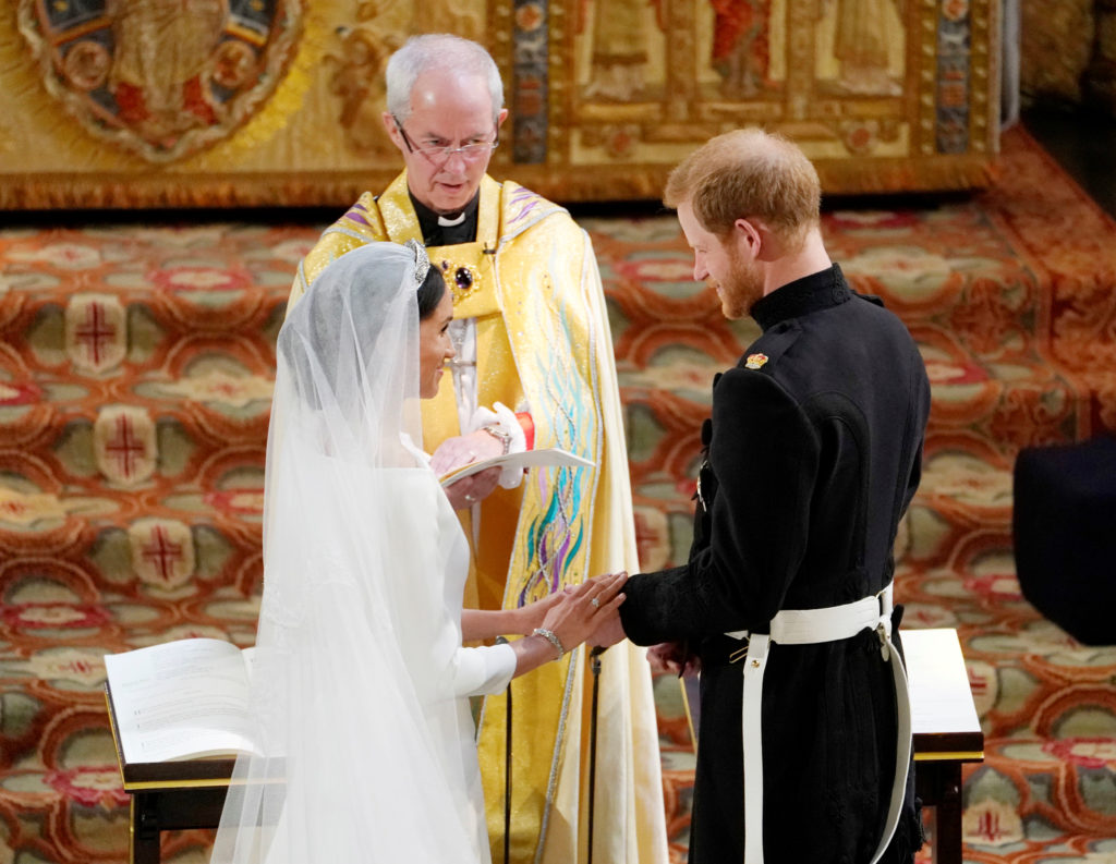 Meghan Markle and Prince Harry exchange vows in St. George's Chapel. The wedding was conducted by the Archbishop of Canterbury Justin Welby. Photo by Owen Humphreys/Pool via Reuters