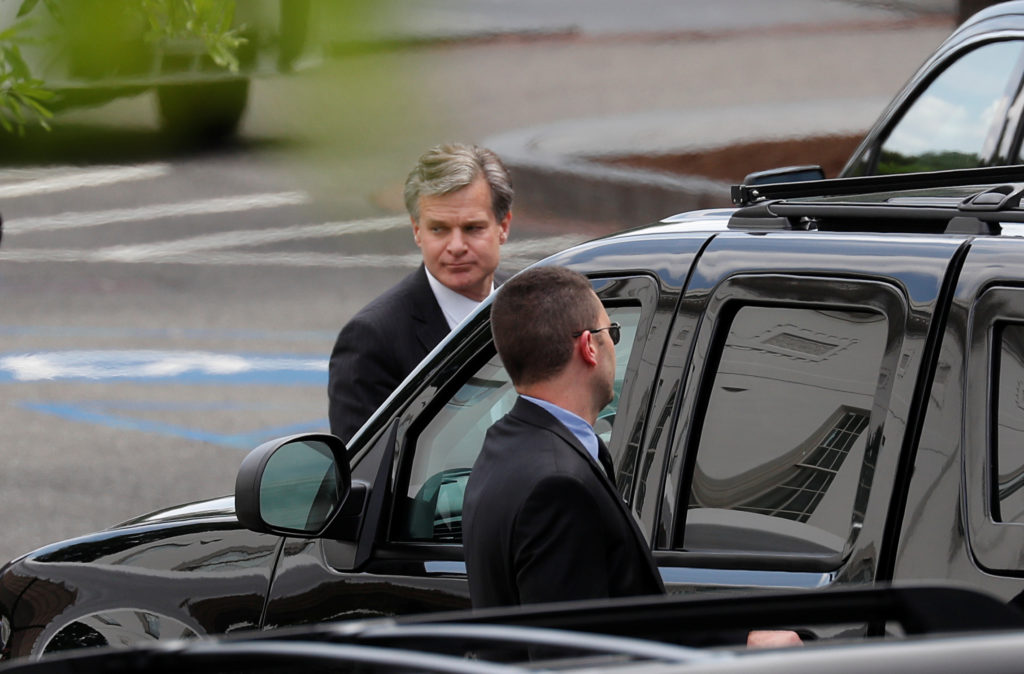 FBI Director Christopher Wray departs after a meeting with President Donald Trump on FBI investigations into Russia and the 2016 Trump presidential campaign at the White House in Washington D.C