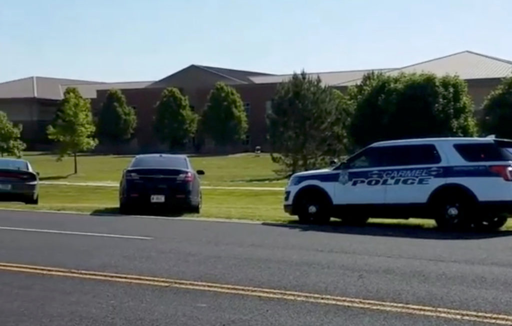 Police is seen near Noblesville West Middle School in Noblesville, Indiana, in this still image obtained from social media...