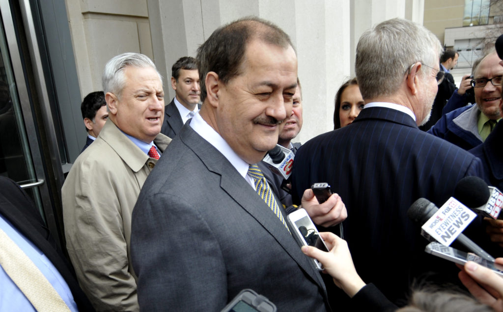 Former Massey Energy Chief Executive Don Blankenship (C) smiles outside the Robert C. Byrd U.S. Courthouse just moments after the verdict was handed down to him in Charleston, West Virginia, in 2015. Photo by Chris Tilley/Reuters