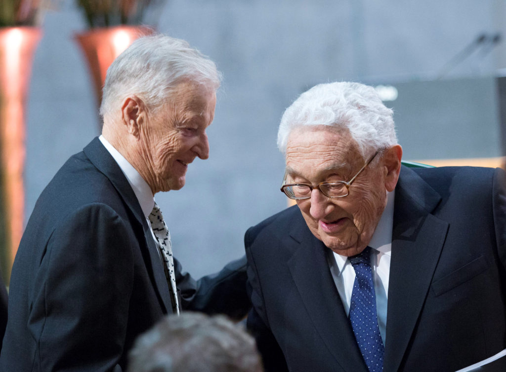 Former U.S. national security adviser Zbigniew Brzezinski and former U.S. Secretary of State Henry Kissinger. File photo by NTB Scanpix/Terje Bendiksby/via Reuters
