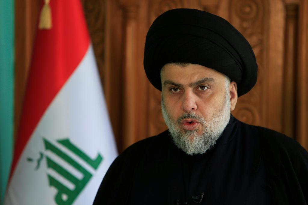 Iraqi Shi'ite leader Muqtada al-Sadr delivers a speech in Najaf, Iraq December 11, 2017. REUTERS/Alaa Al-Marjani - RC1CEA1...