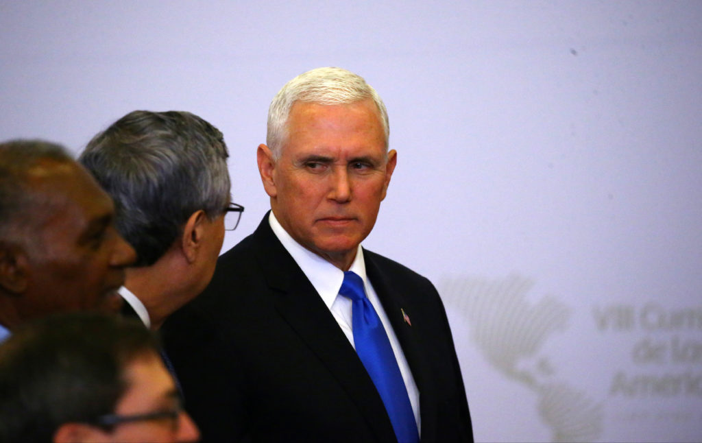 Vice President Mike Pence attends the family photo of the VIII Summit of the Americas in Lima, Peru. Photo by Ivan Alvarad...